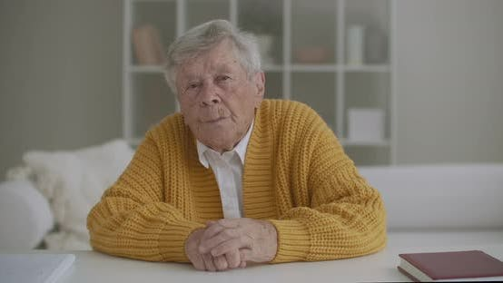 Thumbnail for A Grandmother with a Yellow Sweater Looks at the Camera and Listens To the Doctor Advice on Video