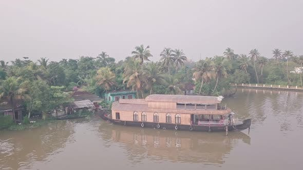 Houseboat in Kerala backwaters at Alleppey, India. Aerial drone view