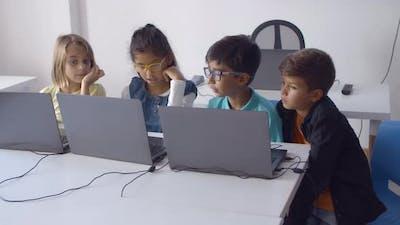 Group of Classmates Doing Task Together