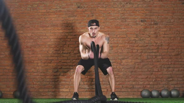 Thumbnail for Man with Battle Rope Battle Ropes Exercises in Fitness Gym. Cross Fit Concept