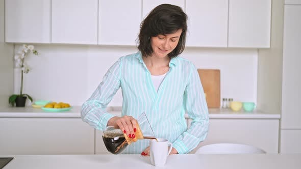 Cheerful Female Holding Pourover Coffee Maker