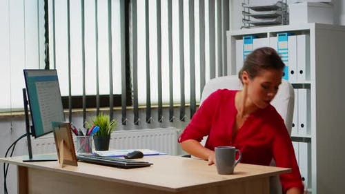 Woman Using Laptop and Pc