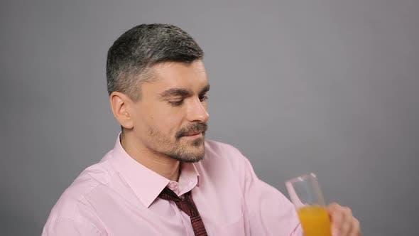 Thumbnail for Man Drinking Fresh Orange Juice and Enjoying Taste Healthy Lifestyle