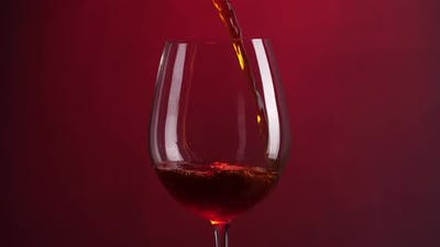Wine Is Pouring Into A Wine Glass