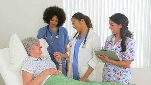 Thumbnail for Caucasian patient receives positive news from her multiracial doctors and nurse