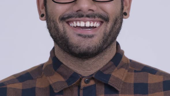 Thumbnail for Smile of Happy Young Bearded Indian Hipster Man