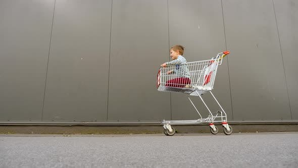 Cover Image for Shopping Concept. Black Friday Background. Father with Son Hurry Up for Discounts. Consumption