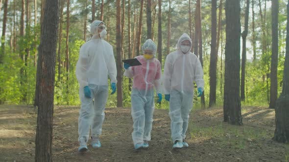 Scientists in Biohazard Suits Examining Level of Radiation