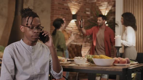 Thumbnail for African-American Man Having Telephone Talk during Party