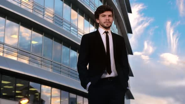 Thumbnail for Businessman Having Great Idea Standing in Front of the Business Center.