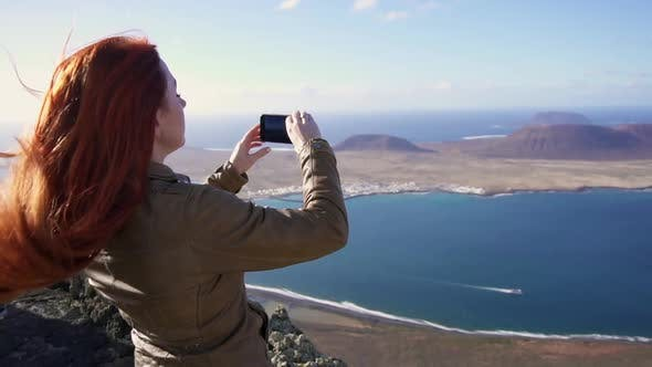 Thumbnail for Happy Woman Tourist Shoots Video of Beautiful View of Islands Using Smartphone