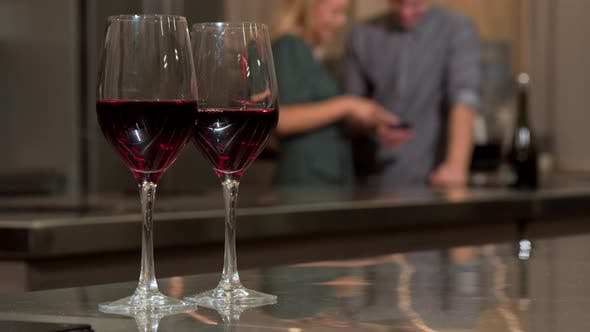 Thumbnail for Wine Glasses on the Table Couple Using Smartphone Together Background