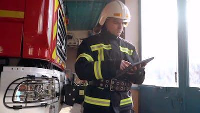 Fireman in Cabin Check Data in Digital Tablet