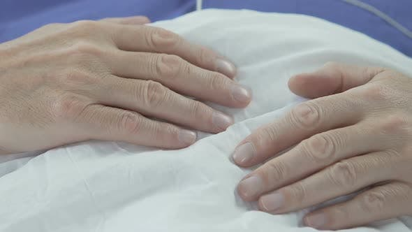 Thumbnail for Hands of Elderly Man Lying on Stomach, Senior Male Sleeping, Having Rest in Bed