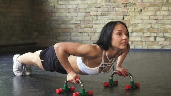 Thumbnail for Athletic Woman Doing Push-ups at the Gym