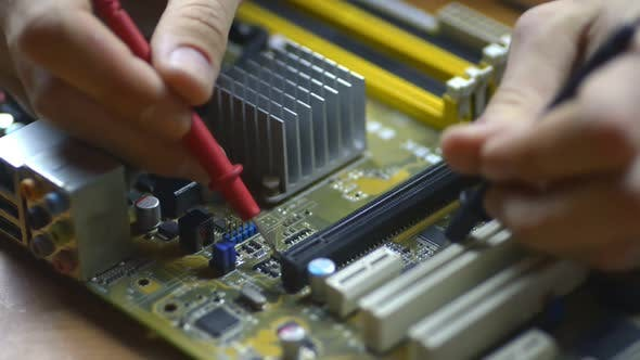 Thumbnail for Electronics Repair Microchips and Circuit Boards at Motherboard. Service Closeup. Electronic