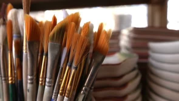 Thumbnail for Painting Brushes In Ceramic Workshop