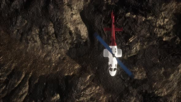 Thumbnail for Slow Motion Helicopter Above Rocky Desert