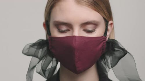 Close Up of Female Model in Stylish Face Mask