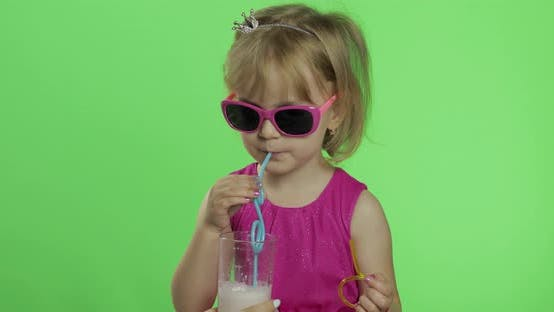 Thumbnail for Happy Four Years Old Child in Pink Dress Drinks Milkshake Cocktail. Chroma Key