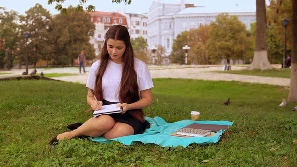 Thumbnail for Girl Handwriting in Park