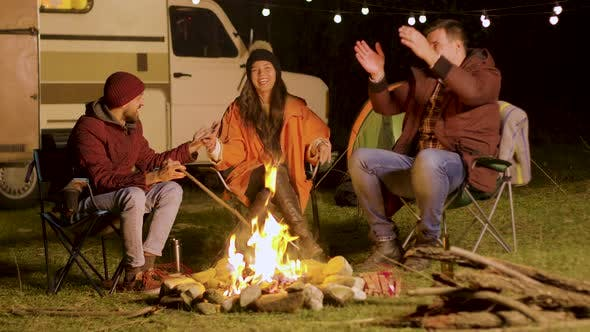 Thumbnail for Bearded Man Telling a Funny Joke To His Friends Around Camp Fire