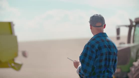 Thumbnail for Farmer Using Digital Tablet While Examining Field