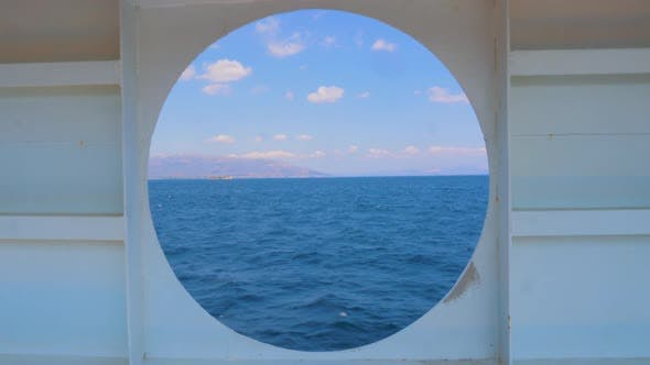 Thumbnail for Summer Seascape From Round Window of the Yacht. Water Transport. Travel Concept. View of the Sea