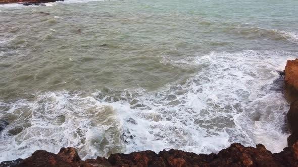 Thumbnail for Ocean Wave Crashing Upon Rocks