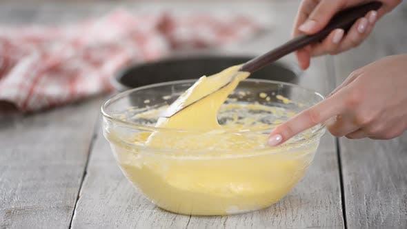 Stirring Cake Batter in a Mixing Bowl.