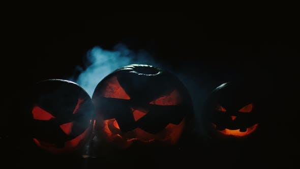 Thumbnail for Scary Carved Halloween Pumpkins with Smoke at The Background