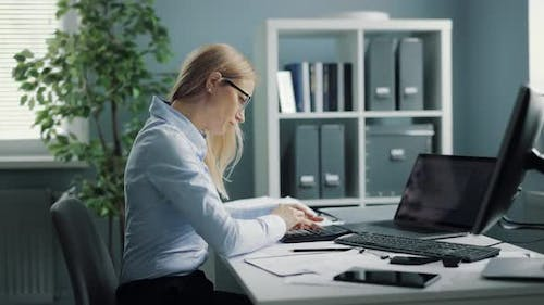 Woman Working Overtime at Office