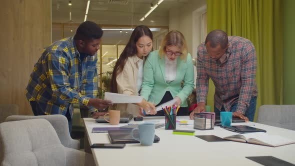 Diverse Business Colleagues Discussing Paperwork