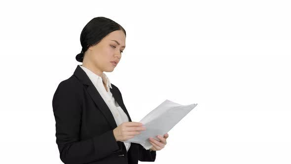 Thumbnail for Serious Cute Businesswoman Reading Documents on White Background