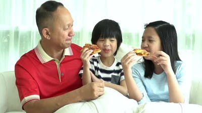 Asian Family Eating Pizza Together