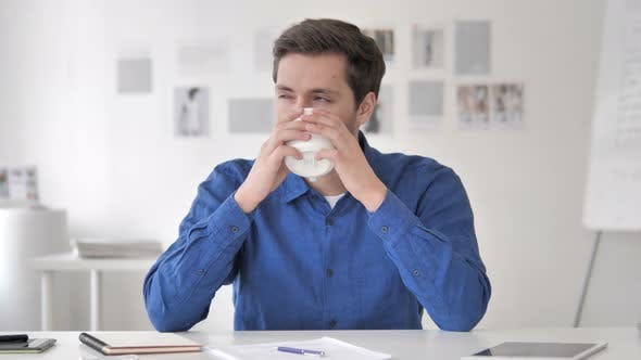Cover Image for Relaxing Casual Man Drinking Coffee at Work