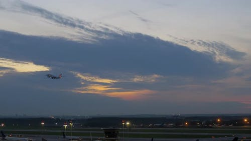 Passenger Airplane Taking Off in the Dusk