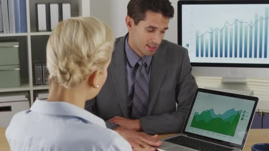 Thumbnail for Business colleagues discussing sales data