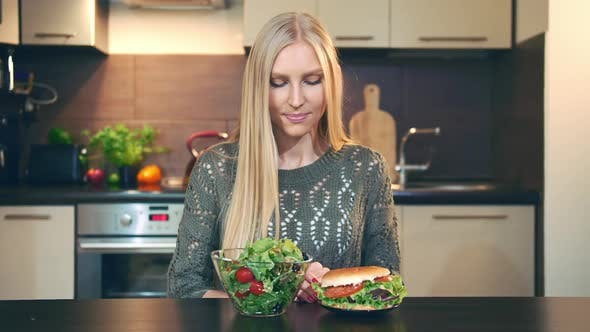 Girl Preferring Salad to Hamburger