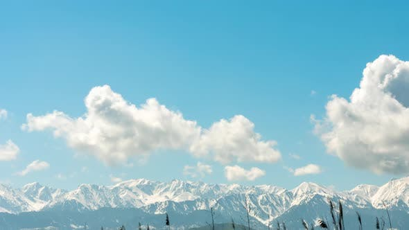 Thumbnail for Timelapse Snowy Mountains and Clouds