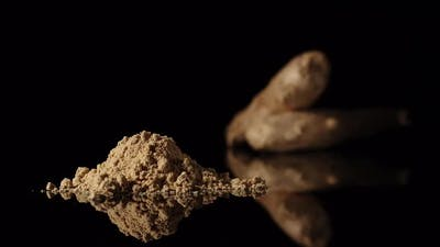 Ginger Powder Appearing Near To Ginger Root