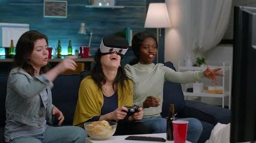 Black Woman Experiencing Virtual Reality Headset Winning Video Games