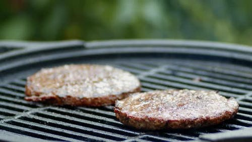 A Burger of Fresh Meat Is Grilled with Smoke.
