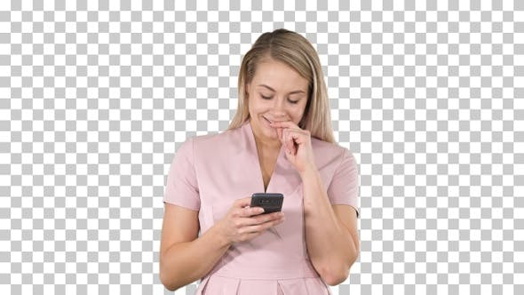 Blonde girl holding mobile phone Young woman cellphone