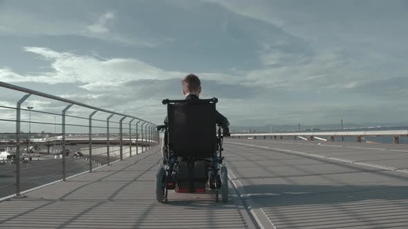 Thumbnail for Handicapped Boy in Electric Wheelchair Outdoor