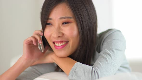 Thumbnail for Chinese woman talking to a friend on her iphone