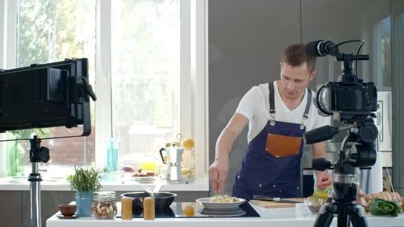 Thumbnail for Cook Preparing Scrambled Eggs on Camera