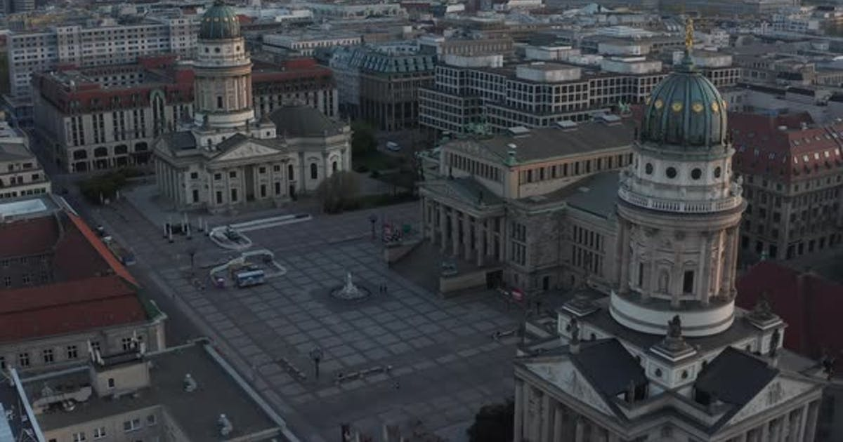 AERIAL: Empty Berlin Gendarmenmarkt Square with View on German Church, Konzerthaus and French Church