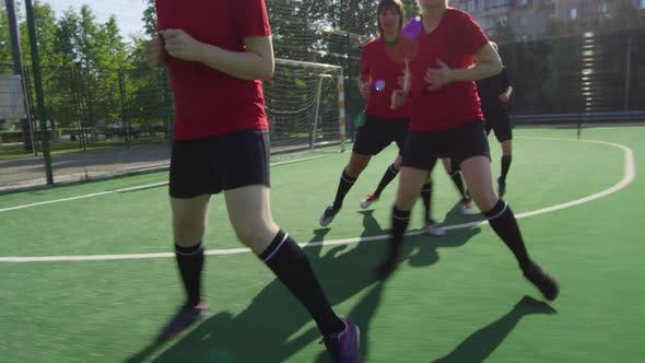 Female Athletes Doing Lateral Run Exercise on Soccer Field