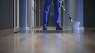 Janitor Cleaning a Corridor